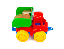 Toy car truck and money coins Stock Photo