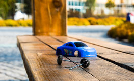 The toy car. A toy car was lonely cast on a park bench, as if we lost out of childhood Royalty Free Stock Image