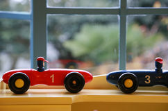 Toy of the car by the window. Toy of the car of the race car of the red and blue by the window Stock Image
