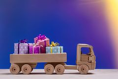 Free Toy Car With Gifts In Boxes On Festive Background. Royalty Free Stock Photography - 102372017