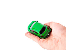 Toy car woman hand. Purchase insurance travel concept isolated Royalty Free Stock Images
