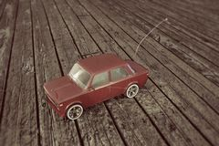 Toy car on wooden parquet Stock Photos