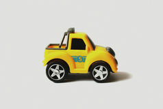 Toy car. Yellow toy car is presented on a white background Royalty Free Stock Images