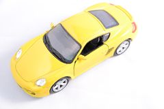Toy car. Yellow toy car on white background Royalty Free Stock Image