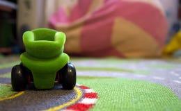 Toy carpet car focus Royalty Free Stock Image