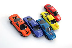 Toy cars. Over a white background Stock Photos