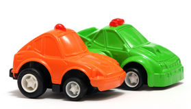 Toy Cars. Tiny orange and green toy car for fun Stock Images