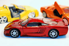 Toy Cars. This is a shot of 3 toy cars. The focus is on the car in the fore ground Stock Images
