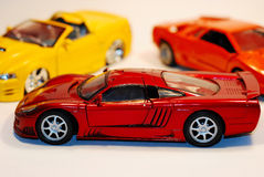 Toy Cars. This is a shot of 3 toy cars. The focus is on the car in the fore ground Royalty Free Stock Photo