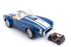Toy cars. Two model cars over white background Royalty Free Stock Photos