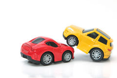 Toy cars in accident on a white background Stock Images