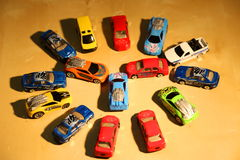 Toy cars. Arranged in circular on the table Stock Images