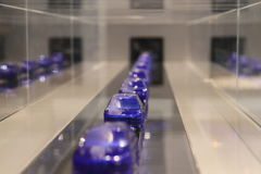 Toy cars on assembly line. Plastic toy cars on an assembly line stock photo