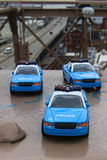 Toy cars on Brooklyn bridge Royalty Free Stock Photography
