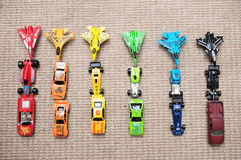 Toy cars collection on carpet.Sorted by color. Transportation, airplane, plane and helicopter toys for children, miniature models Stock Image