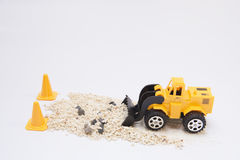 Toy cars are digging Royalty Free Stock Images
