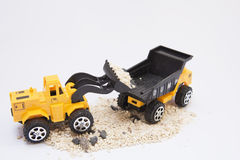 Toy cars are digging Royalty Free Stock Photography