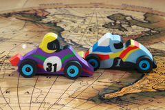 Toy cars drive on a geographic map Royalty Free Stock Photos