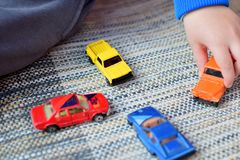 Toy cars game. Boy playing with toy cars Stock Photography
