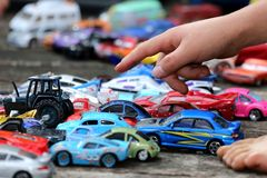 Toy Cars Game. Young boy playing with his big collection of toy cars Royalty Free Stock Photography