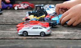Toy Cars Game. Young boy playing with his big collection of toy cars Stock Images