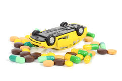 Toy cars and medicine Stock Photos
