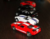 Toy cars. Miniature models of different cars Stock Photos