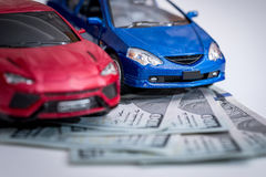 Toy cars with money Royalty Free Stock Images
