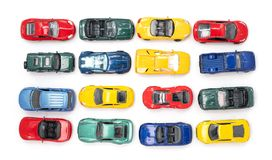 Toy cars in neat rows. Of the four primary colours royalty free stock image
