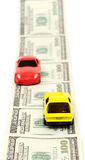 Toy Cars Over A Lot Of Dollar Bills Stock Images