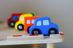 Toy cars. Row of colorful wooden toy cars Stock Images
