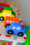 Toy cars. Row of colorful wooden toy cars Stock Photography
