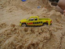 Toy Cars. On a sandy beach Royalty Free Stock Photography