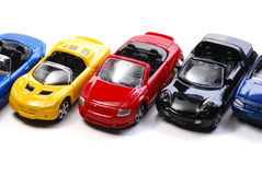 Toy Cars. A series of colourful toy cars against a white backdrop Stock Image
