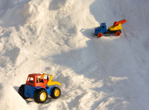 Toy cars in snow Royalty Free Stock Photos