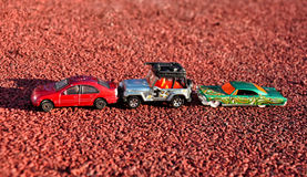 Toy cars. Three colorful toy cars in line Stock Photography