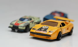 Toy cars. Worn out small toys sports cars Royalty Free Stock Photo