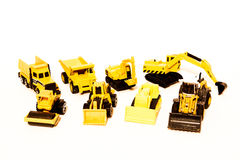 Toy cars. Yellow construction machines toys isolated on the white background Stock Photo
