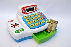Toy cash register machine. Toy cash register used and a dollar bill Stock Photography