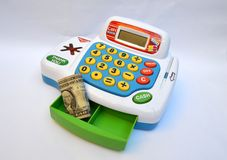 Toy cash register machine. Toy cash register used and a dollar bill Stock Photo