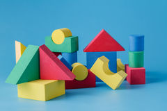 The toy castle from color blocks on  blue background Stock Photography