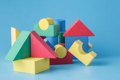 The toy castle from color blocks on  blue background Royalty Free Stock Photos