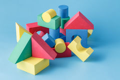 The toy castle from color blocks on  blue background Stock Images