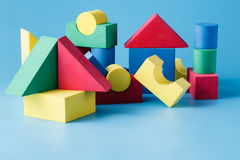 The toy castle from color blocks on  blue background Royalty Free Stock Image