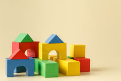 The toy castle from color blocks isolated on beige background Royalty Free Stock Photos