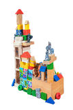 The toy castle from wooden blocks. On a white background Royalty Free Stock Photography
