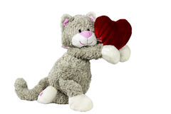 Toy cat gives heart. Valentine`s day Royalty Free Stock Photos