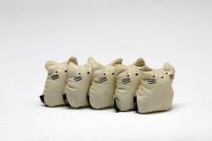 Toy Cats. Bean Stuffed toy cats standing in a line - This is set of Five-Stones, a popular game that children in south east asia plays Royalty Free Stock Photos