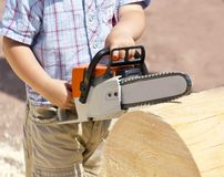 Toy chainsaw  child. Toy chainsaw in the hands of the child Royalty Free Stock Image