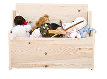 Toy Chest. Various toys in a hand crafted toy box isolated on white background Royalty Free Stock Images